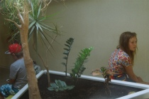 this is theo waiting with the plants in the changing rooms after swimming.